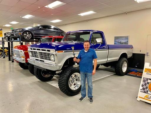 Doug in his garage with truck.jpg