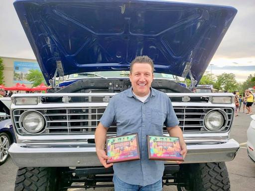 Doug with open truck hood and awards.jpg