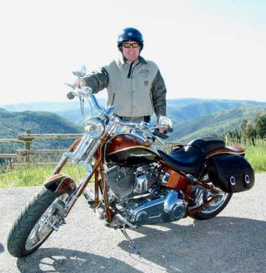 Doug in front of mountains on motorcycle
