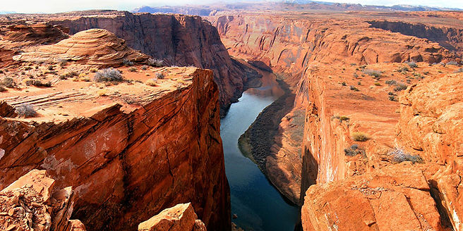 A Canyon with a river running along it's base, snaking out into the horizon.
