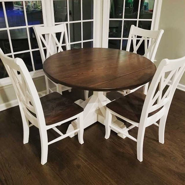 Round pedestal table in antique walnut with double x chairs