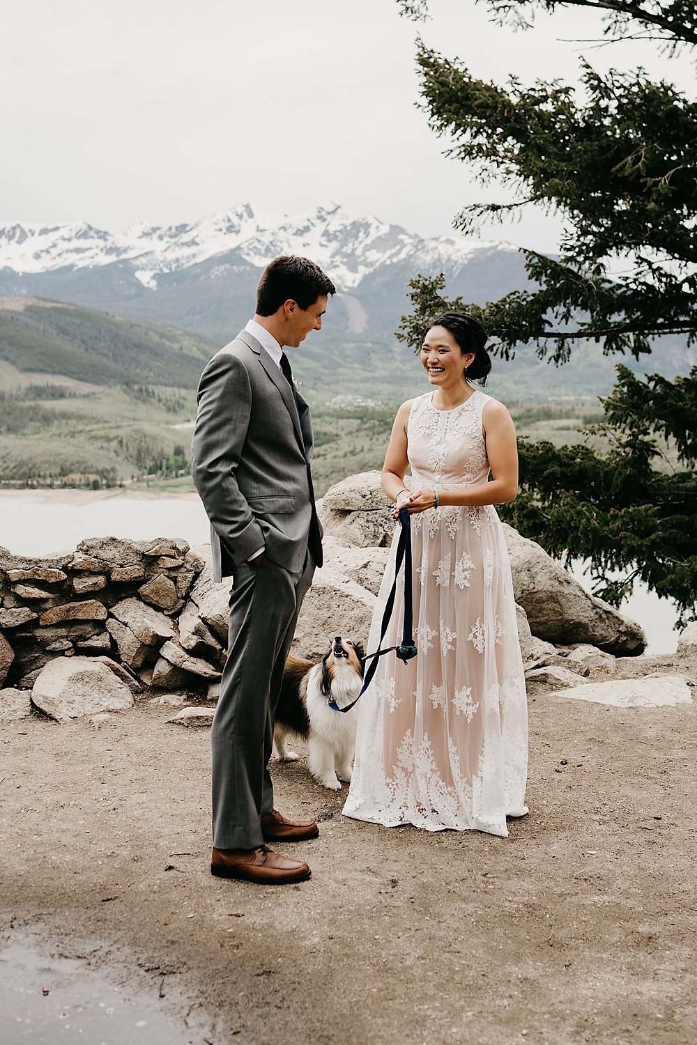 Bride and Groom with dog at Sapphire Point Breckenridge