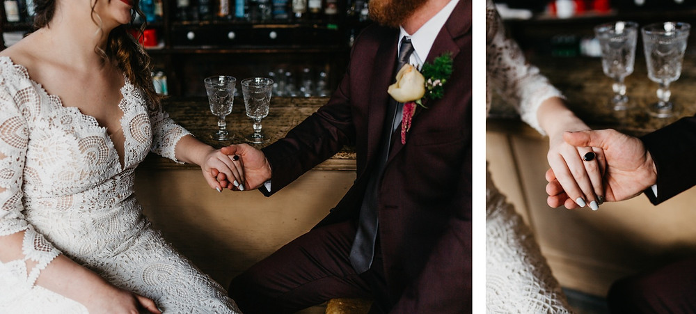 Bride and Groom hold hands wedding ring at Bread bar silver Plume Colorado