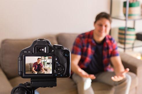 vlogger-recording-social-media-video-whi