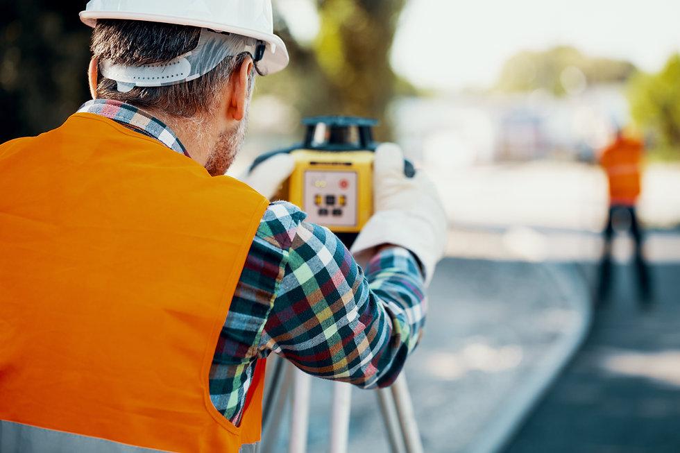 Land Surveyor using mapping equipment