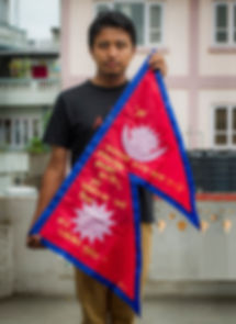 Art warning the World, Nepal - Kailash K Shrestha and his flag with the Klaus Guingand sentence in Nepali / Gold paint / Signed