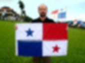 Art warning the World, Panama - Frank Ferrer and his flag with the Klaus Guingand sentence in Spanish / Flag: 23 x 35,4 in. / Sentence silver & white paint / Signed