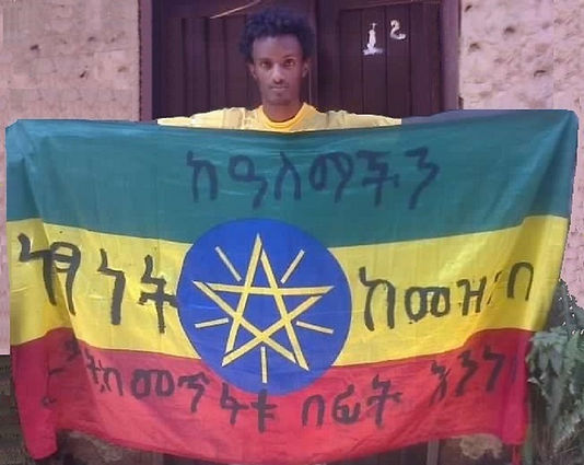 Art warning the world, Ethiopia - Sisay Bekele and his flag with the Klaus Guingand sentence in Amharic / Black paint / Signed