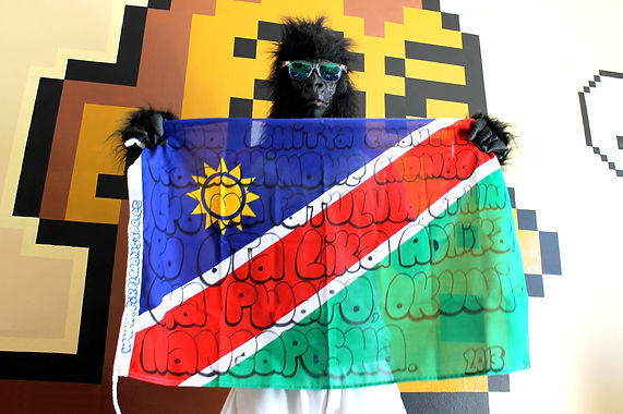 Art warning the World, Namibia - Pixel Monster and his flag with the Klaus Guingand sentence in Oshiwambo / Black marker pen / Signed