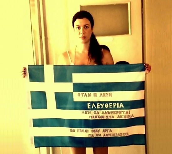 Art warning the World, Greece - Demi Kaia and her flag with the Klaus Guingand sentence in Greek / black marker & white paint / Signed