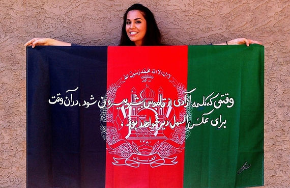 Art warning the World, Afghanistan - Meena Saifi and her flag with the klaus Guingand sentence in Pashto  / Flag: 35,5 x 59 in.: / Sentence white acrylic paint / Signed