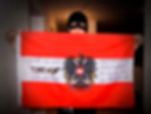Art warning the World, Austria - MeerSau and his flag with the Klaus Guingand sentence in German / Gray & black paint / Signed