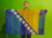 Art warning the World / Bosnia - Ljubomir Todorovic and his flag with the Klaus Guingand sentence in Bosnian / Black marker / Signed