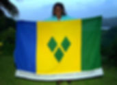 Art warning the World, St Vincent and the Grenadines - RoseMarie Lewis and her flag with the Klaus Guingand sentence in English / Flag: 35,5 x 59 in. / Sentence digital printing on fabric sewn / Signed