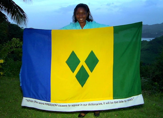Art warning the World, St Vincent and the Grenadines - RoseMarie Lewis and her flag with the Klaus Guingand sentence in English / Flag: 35,5 x 59 in./ Sentence digital printing on fabric sewn / Signed