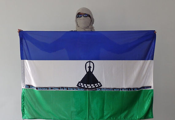 Art warning the World, Lesotho - Khotso and his flag with the Klaus Guingand sentence in Sesotho / Black and blue paint / Signed