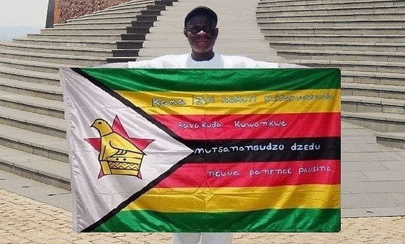 Art warning the World, Zimbabwe - Phillip Sampruru and his flag with the Klaus Guingand sentence in Shona / White paint / Signed