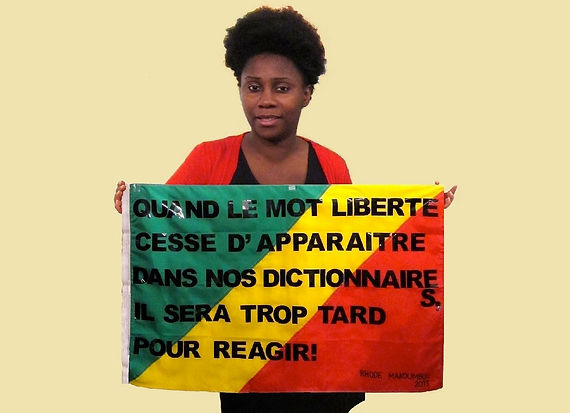 Art warning the world, Congo - Rhode Makoumbou and her flag: 19,68 x 23.62 inches / Sentence in French / Black pasted letters / Signed