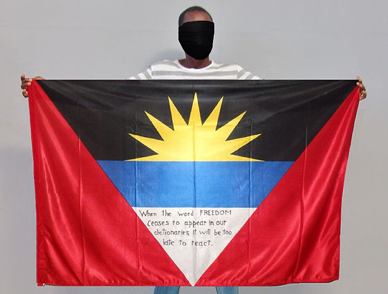 Art warning the world, Antigua and Barbuda -Michael T. and his flag: 35,5 x 59 inches:Klaus Guingand Sentence in English / Black marker pen / Signed