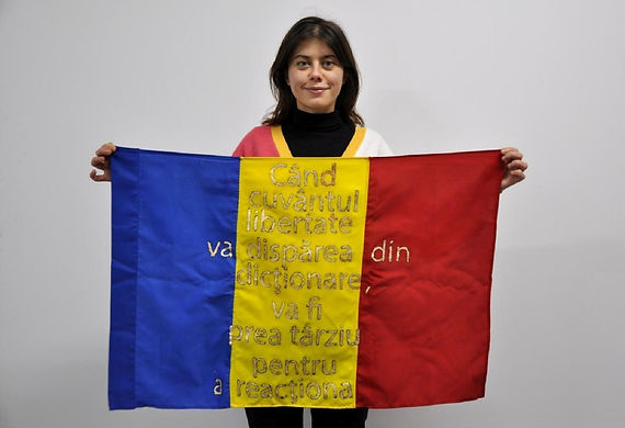 Art warning the World, Romania - Floriama Candea and her flag with the Klaus Guingand sentence in Romanian / Flag: 23 x 35,4 in. / Sentence gold paint / Signed