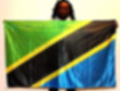 Art warning the World, Tanzania - Mmbando Kennedy and his flag with the Klaus Guingand sentence in Kiswahili.