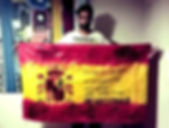 Art warning the World, Spain -  David Heras Verde and his flag with the Klaus Guingand sentence in Spanish / Flag: 35,5 x 59 in./ Sentence red & yellow paint, black stencil /Signed