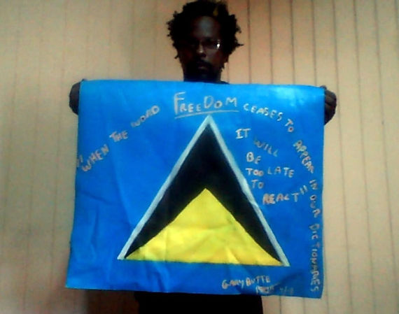 Art warning the World, St. Lucia - Gary Butte and his flag with the Klaus Guingand sentence in English / Flag: 23,62 x 23,62 in./ Sentence white paint / Signed