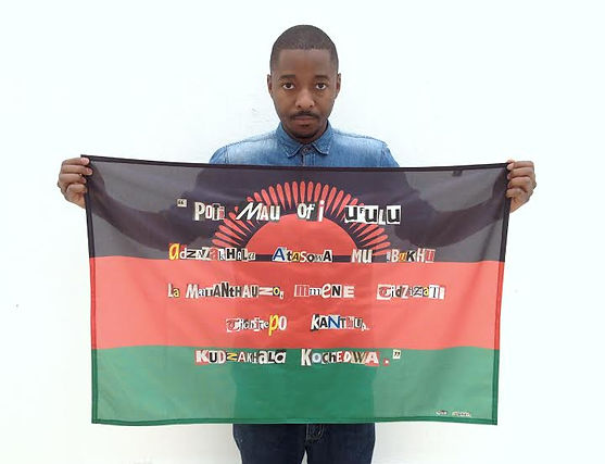 Art warning the World, Malawi -Stainer Chindebvu and his flag with the Klaus Guingand sentence in Chichewa / Flag: 19,68 x 45,27 in. / Sentence cut and pasted letters / Signed