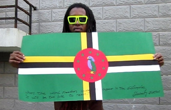 Art warning the wold, Dominica - Shadrach Burton and his flag with the Klaus Guingand sentence in English / Black pen / Signed
