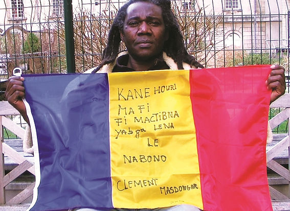 Art warning the world, Chad - Clement Masdongar  and his flag: 23 x 35,4 inches / Sentence in Chadian Arabic / Black paint / Signed
