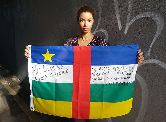 Art warning the World / Central African Republic - Kiki Bokassa and her flag with the Klaus Guingand sentence in Sango.