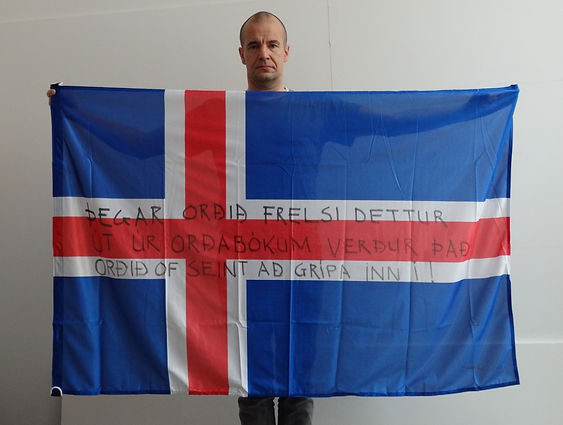 Art warning the World, Iceland - Snorri Asmundsson and his flag with the Klaus Guingand sentence in Icelandic / Black marker / Signed