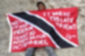 Art warning the World,Trinidad and Tobago - Richard Mark Rawlins and his flag with the Klaus Guingand sentence in English.