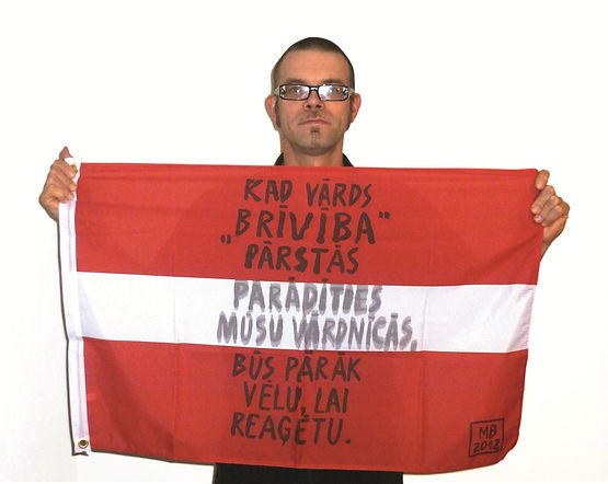 Art warning the World, Latvia - Modris Braslins and his flag with the Klaus Guingand sentence in Latvian / Black marker pen / Signed