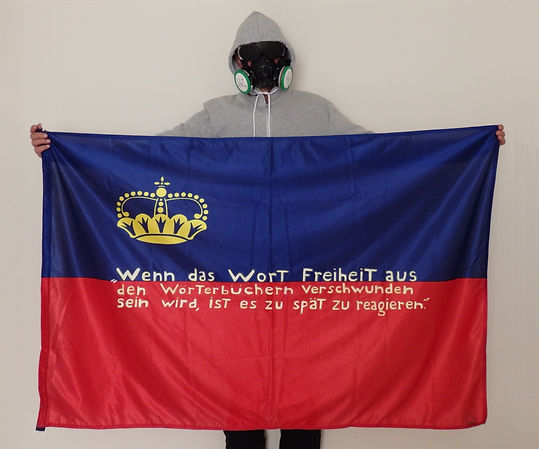 Art warning the World, Liechtenstein -  Baed and his flag with the Klaus Guingand sentence in German / Flag: 35,5 x 59 in. / Sentence white & gold paint / Signed