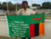 Art warning the World, Zambia - Montfort John Chinunda and his flag with the Klaus Guingand sentence in Bemba / White paint / Signed