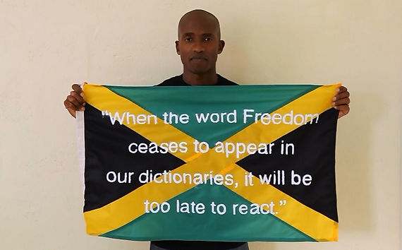 Art warning the World, Jamaica - Garfield Morgan and his flag with the Klaus Guingand sentence in English / White paint / Signed