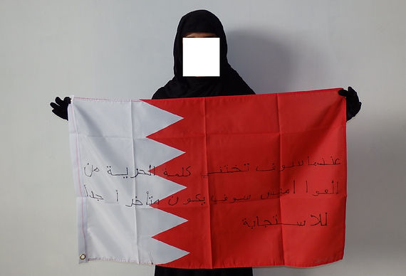 Art warning the World, Bahrain -Yasmeen and her flag with the Klaus Guingand sentence in Arabic / Black marker / Signed