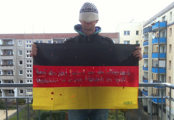 Art warning the World, Germany - Undenk member and his flag with the Klaus Guingand sentence in German / White & black marker / Signed