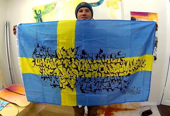 Art warning the World, Sweden - Ola Kalnins and his flag with the Klaus Guingand sentence in Swedish / Black marker pen / Signed