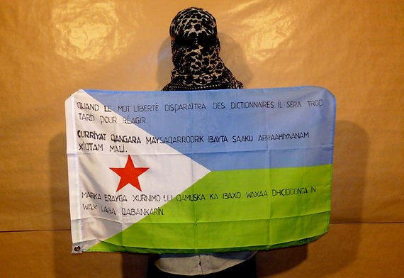 Art warning the world ,Djibouti - Ibrahim and his flag: 23 x 35,4 inches / Klaus Guingand sentence in French, Afar & Somali / Black marker stencil / Signed