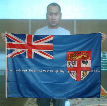 Art warning the World, Fiji - John Mausio and his flag with the Klaus Guingand sentence in Fijian / White marker / Signed
