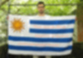 Art warning the World, Uruguay - Juan Manuel Rodríguez and his flag with the Klaus Guingand sentence in Spanish. / Flag: 35,5 x 59 in./ Sentence pink serigraphy / Signed