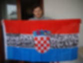 Art warning the world, Croatia - Slaven Lunar Kosanovic and his flag: 31,49 x 59 inches / Klaus Guingand sentence in Croatian / Black marker / Signed