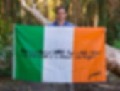 Art warning the World - Ireland - ArtByEoin and his flag with the Klaus Guingand sentence in Irish / Black marker / Signed