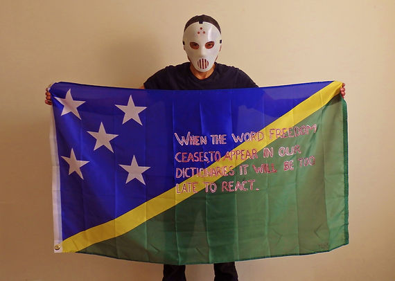 Art warning the World, Solomon Islands -Meers and his flag with the Klaus Guingand sentence in English / Flag: 35,5 x 59 in./Sentence red & white paint / Signed