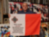 Art warning the World, Malta - Ray Piscopo and his flag with the Klaus Guingand sentence in Maltese / Flag: 23 x 35,4 in. / Sentence digital printing / Signed