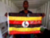 Art warning the World,Uganda - Eria Nsubuga and his flag with the Klaus Guingand sentence in Swahili.