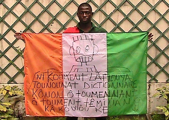 Art warning the World, Ivory Coast -Aboudia and his flag with the Klaus Guingand sentence in Odienneka / Black marker pen / Signed