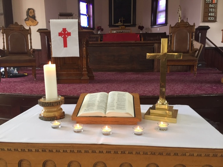 Bible on Front Table with Pulpit in the